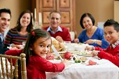 stock photo of christmas meal  - Multi Generation Family Celebrating With Christmas Meal - JPG