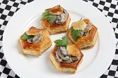 A plate of homemade mushroom vol-au-vents garnished with a parsley leaf