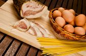 Spaghetti carbonara ingredients, bacon, eggs, pasta