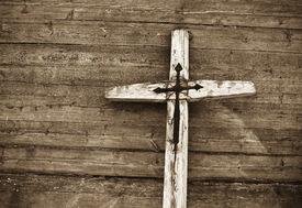 image of christian cross  - Old wooden cross against wooden background - JPG