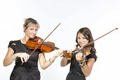 Mother and daughter play violins