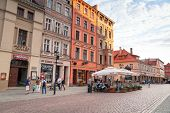 TORUN, POLAND - AUG 15: Unidentified people walking on the old town of Torun - 15 of August 2013. To