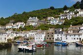 Boats in Polperro fishing village harbour Cornwall England UK