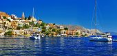 sailing boats in pictorial bay in Symi island, Greece, Dodecanes