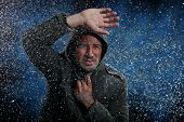 Man with parka in a snow storm