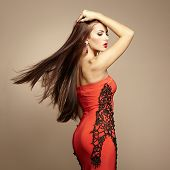 foto of showgirl  - Fashion photo of young magnificent woman in red dress - JPG