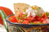 Spicy salsa with tortilla chips and ingredients