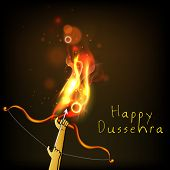 Indian festival Happy Dussehra background with bow and arrow in fire.