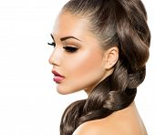 Hair Braid. Beautiful Woman with Healthy Long Hair. Hairdressing. Hairstyle. Beauty Makeup. Fashion