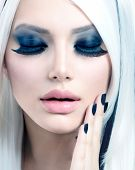 Beauty Fashion Girl black and white style. Smoky Eyes Make up, False Eyelashes and Long White Hair w