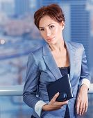 Businesswoman on the meeting, attractive serious female waiting for a business partners, big boss in