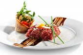 stock photo of yolk  - Beef Tartare with Eggs Yolk - JPG