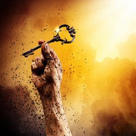 stock photo of struggle  - Key in human hand - JPG