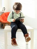 Adorable, cute kid with tablet