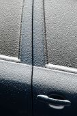 stock photo of ice-scraper  - Close-up shot of a car