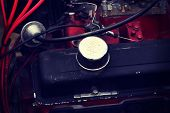 Close up on automotive engine compartment, old car