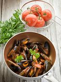 mussel  with tomato sauce and basil over casserole