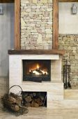 stock photo of cozy hearth  - Hot fire in chimney in a room - JPG