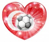 stock photo of crescent-shaped  - Turkey soccer football ball flag love heart concept with the Turkish flag in a heart shape and a soccer ball flying out - JPG