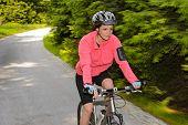 Woman mountain biking motion blur cycling path training race