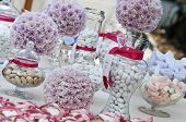 stock photo of confetti  - wedding table with sweet confetti and candies - JPG