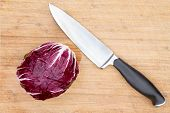 Red Radicchio With A Kitchen Knife