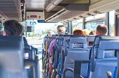 stock photo of motor coach  - View from inside the bus with passengers - JPG