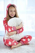 stock photo of pajamas  - Portrait of child in soft warm pajamas sitting on the carpet at home - JPG