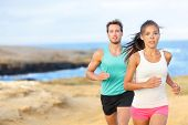 People jogging for fitness running in beautiful landscape nature outdoors. Woman and man sports athl