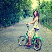 Happy young beautiful woman with retro bicycle, summer outdoor, toned