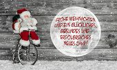 Merry Christmas Card In Red And White With German Text And A Santa Claus With Globe.