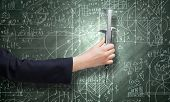 Close up of business person hand measuring bulb