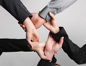 Close up of ring of hands isolated on background. Symbolic, teamwork, cooperation, ties, business te
