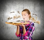 Young pretty woman in casual holding opened book