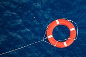 Lifebuoy in a stormy blue sea, safety equipment in boat