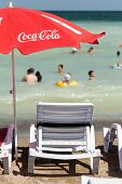 Coca Cola Umbrella On Beach