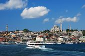 ISTANBUL, TURKEY - AUGUST 7, 2007: Ferry boats traverse the Golden Horn bay. The ferry is the fastes