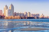 Buildings Close To The Frozen River