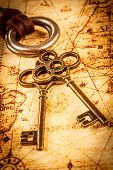 picture of skeleton key  - Old keys on an ancient world map - JPG