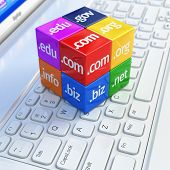 Domain concept. Cubes on white laptop keyboard. 3d