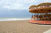 Fairground Roundabout On Brighton Beach. England