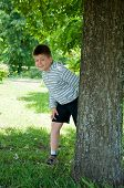 A Boy Plays In The Park