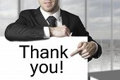 Businessman Pointing On Sign Thank You