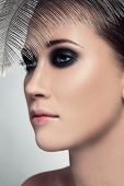 Close-up portrait of young beautiful woman with stylish smoky eyes