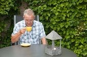 Retired Senior Dutch Man Drinking Coffee