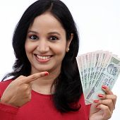 Young woman holding Indian rupee bills