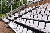 Rows of plastic seating.