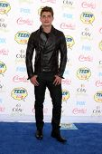 LOS ANGELES - AUG 10:  Gregg Sulkin at the 2014 Teen Choice Awards at Shrine Auditorium on August 10