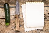 Series Of Fresh Vegitables With Knife At The Wooden Table.