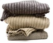 stack of sweaters isolated on a white background